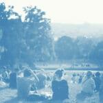 people sitting in a field