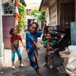 children playing in a city alley way