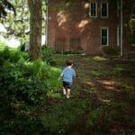 toddler walking in grass